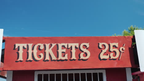 Ancient-Sign-On-Ticket-Kiosk-With-Price-For-Rides