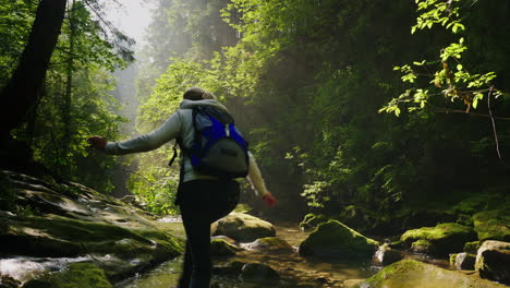 Lost-In-The-Forest-A-Woman-Is-Walking-Along-A-Stream-In-The-Forest-Her-Legs-Are-Wet-Beautiful-Rays-O
