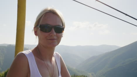 A-Young-Woman-Is-Riding-On-A-Ski-Lift-On-A-Summer-Day-He-Takes-Pictures-Of-Beautiful-Landscapes-Holi