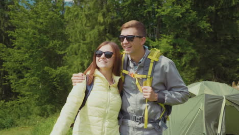 Romantic-Couple-In-A-Hike-They-Stand-In-The-Camping-On-The-Background-Of-The-Tent-Embrace-Hd-Video