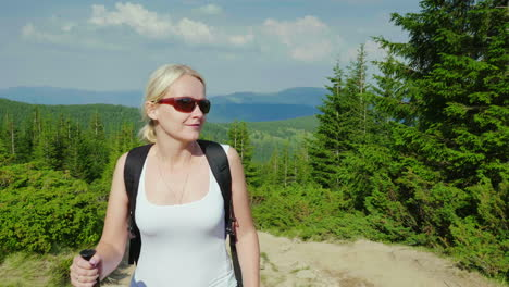 Caucasian-Middle-Aged-Woman-Climbs-A-Mountain-Active-And-Healthy-Lifestyle-Steadicam-Shot