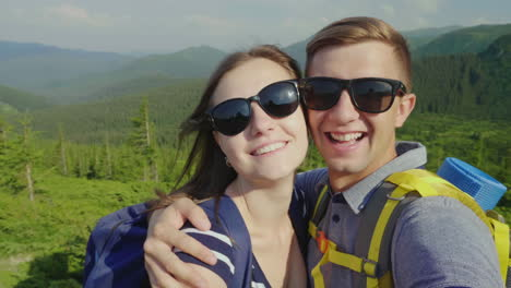 A-Happy-Couple-Of-Tourists-Photographed-Themselves-Smiling-At-The-Camera-Against-The-Background-Of-A