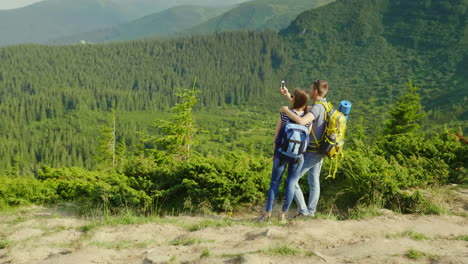 Holidays-In-The-Mountains-In-The-Summer-A-Man-Takes-Pictures-Of-His-Girlfriend-On-A-Beautiful-Backgr