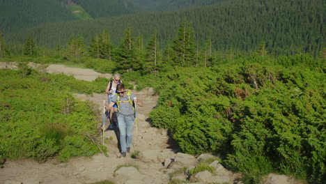 A-Couple-Of-Travelers-With-Backpacks-Go-Up-The-Mountain-Path-4K-Video
