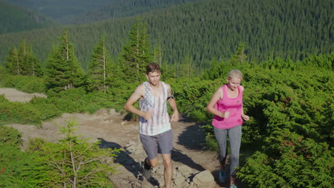Extreme-Running-And-Endurance-Test-A-Man-And-A-Woman-Are-Running-Up-The-Mountain-Path-4K-Video