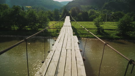 Tension-Rope-Bridge-With-Wooden-Decking-Over-The-Mountain-Stream