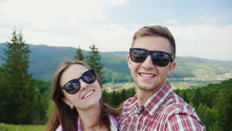 Happy-Couple-Doing-Selfie-On-A-Background-Of-Beautiful-Mountains-Magnificent-Vacation-And-Vacation