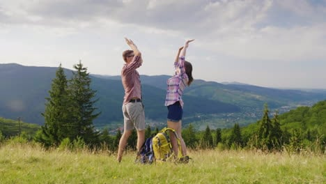 A-Young-Couple-Is-Happy-To-Come-To-A-Resting-Place-In-The-Mountains-Strike-Their-Hands-Hug-Rush-Into