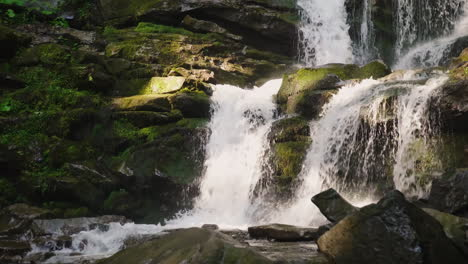 A-Beautiful-Waterfall-In-The-Mountains-Water-Flowing-Over-The-Rocks