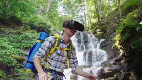 A-Person-In-A-Virtual-Reality-Helmet-Against-The-Backdrop-Of-A-Beautiful-Waterfall