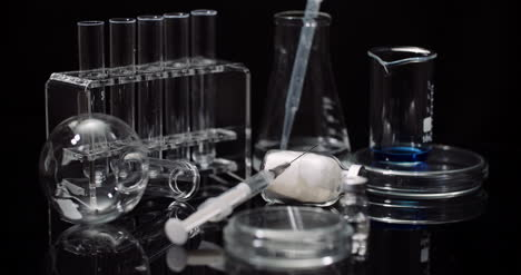 Laboratory-Equipement:-Syringe-And-Medicine-Test-Tubes-And-Flasks-Rotating-On-Black-Background-5