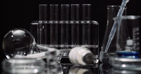 Laboratory-Equipement:-Syringe-And-Medicine-Test-Tubes-And-Flasks-Rotating-On-Black-Background-8