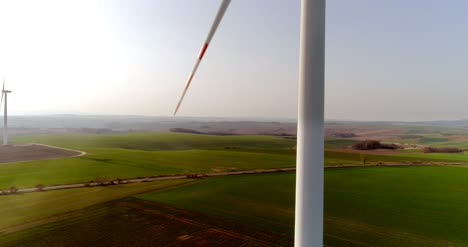 Aerial-View-Of-Windmills-Farm-Power-Energy-Production-11