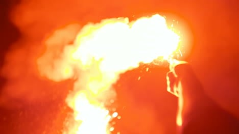 Close-Up-Of-A-Burning-Signal-Flare-Held-By-A-Man-3
