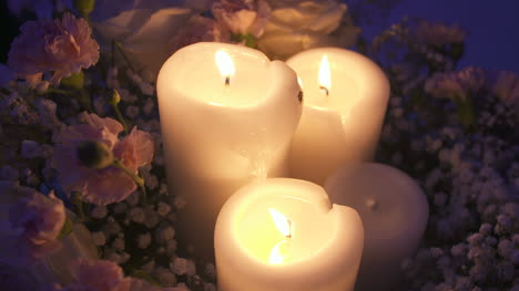Close-Up-Shot-Of-Lit-Candles-During-Wedding-Reception