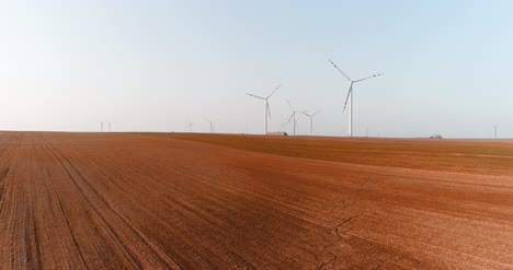 Aerial-View-Of-Windmills-Farm-Power-Energy-Production-24