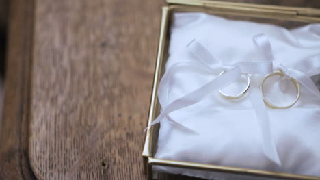 Wedding-Rings-In-Decorated-Box-On-The-Altar-In-Church