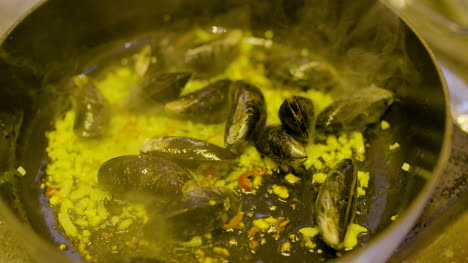 The-Cook-Cooks-Mussels-In-The-Pan