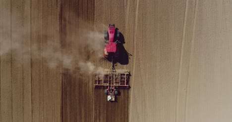 Aerial-Of-Tractor-On-Harvest-Field-Ploughing-Agricultural-Field-