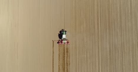 Aerial-Of-Tractor-On-Harvest-Field-Ploughing-Agricultural-Field-1