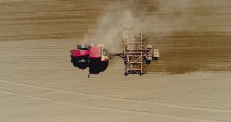 Aerial-Of-Tractor-On-Harvest-Field-Ploughing-Agricultural-Field-7