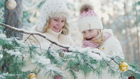 In-Anticipation-Of-Christmas-Mom-And-A-Little-Girl-Decorate-In-The-Yard-Of-The-House-A-Christmas-Tre