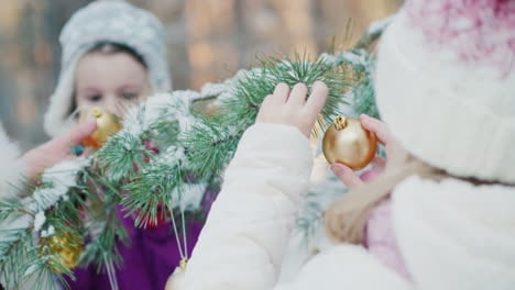 Two-Little-Girl-Friends-In-Warm-Clothes-Decorate-The-Tree-In-The-Courtyard-Of-The-House-White-Snow-L