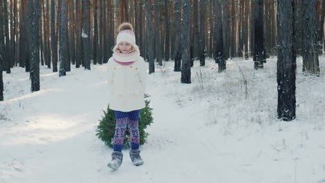 A-Sweet-Girl-Is-Carrying-A-New-Year-Tree-In-A-Sled-Goes-On-A-Snow-Covered-Path-In-The-Winter-Forest