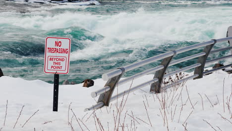 Sign-Warning-Of-Danger-On-Niagara-River-In-Winter