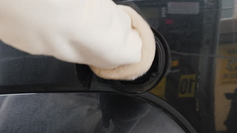 Man-Refuels-His-Car-At-A-Gas-Station-01