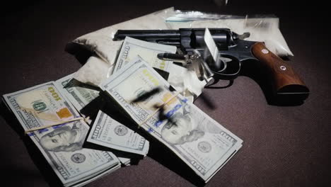 Bullets-Fall-On-Money-And-Drug-Bags