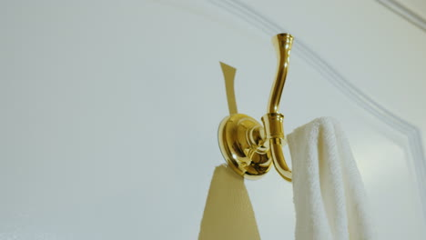 Hang-A-Towel-On-The-Hook-In-The-Bathroom