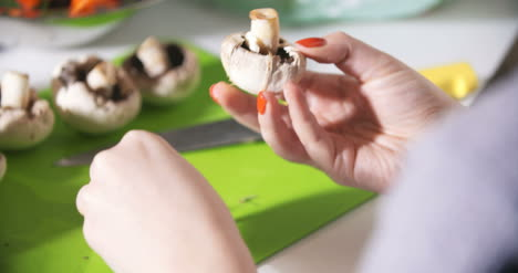 Cleaning-Wild-Mushroom-With-Kitchen-Knife-2