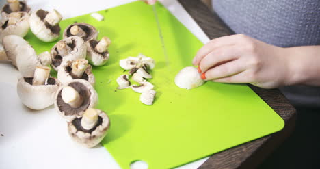 Cuting-Slicing-Mushrooms-In-The-Kitchen-For-Cooking-2