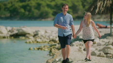 Couple-Holding-Hands-And-Walks-On-Shore-2
