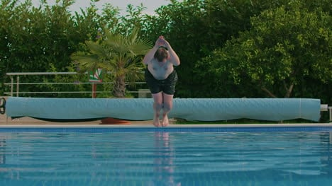 Man-Jumping-Into-Swimming-Pool-1