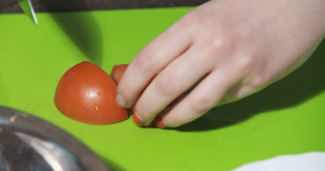Slicing-Tomato-In-Kitchen-1