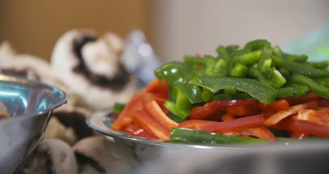 Cut-Green-And-Red-Peppers-In-A-Bowl-1