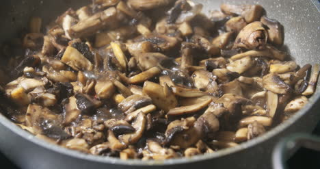 Mushrooms-Being-Cooked-In-Pan-S-1