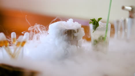Dry-Ice-In-Glass-While-Bartender-Preparing-Drink-1