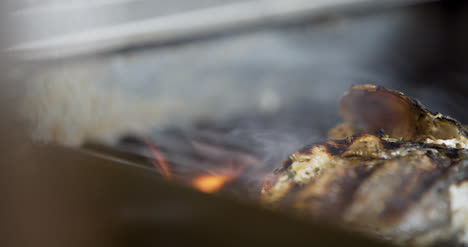 Cook-Grilling-Fish-In-Kitchen-4