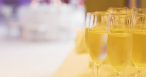 Champagne-Poured-Into-Glases-At-Reception-1