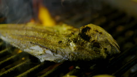 Cook-Grilling-Fish-In-Kitchen-10