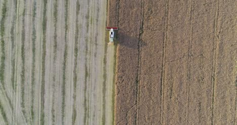 Machinery-Harvesting-Crops-On-Field-13