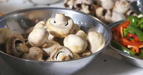 Close-Up-Woman-Taking-Mushrooms-From-Bowl