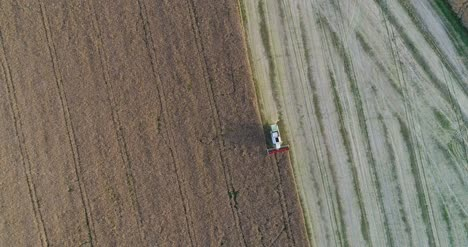 Machinery-Harvesting-Crops-On-Field-7