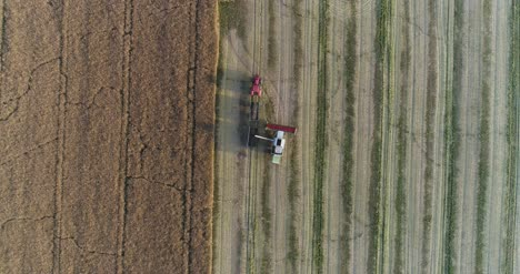 Machinery-Harvesting-Crops-On-Field-10