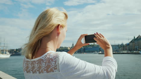 A-Young-Woman-Photographs-A-Beautiful-View-Of-The-City-Of-Stockholm-Travel-In-Sweden