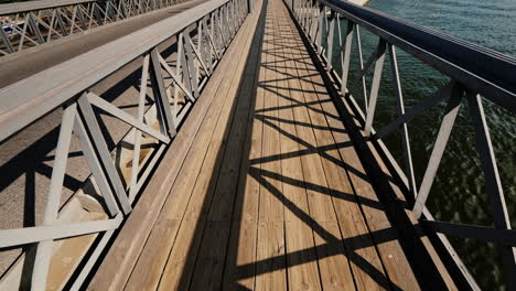First-Person-View-Of-The-Pedestrian-Section-Of-The-Bridge-Over-The-River-Stockholm-Sweden-Pov-Video