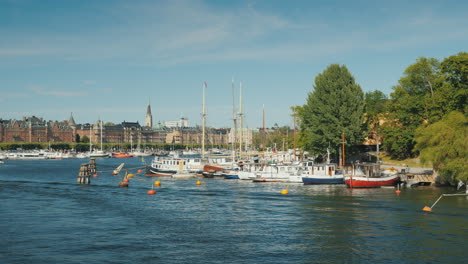 Quay-In-Sokholm-Beautiful-Yachts-Are-Moored-Boats-With-Tourists-Are-Swimming-Beautiful-European-City